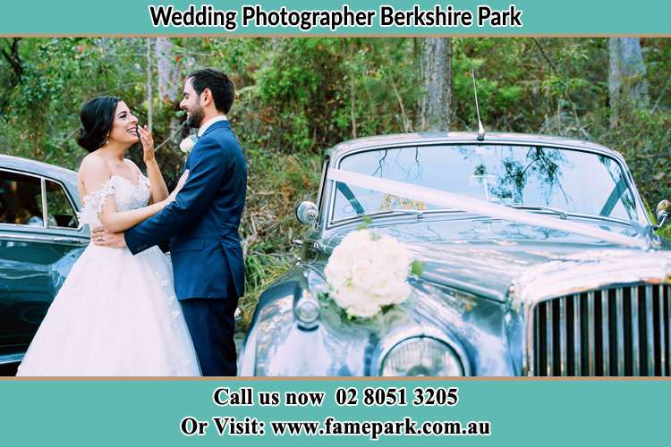 Photo of the Bride and the Groom near the bridal car Berkshire Park NSW 2765