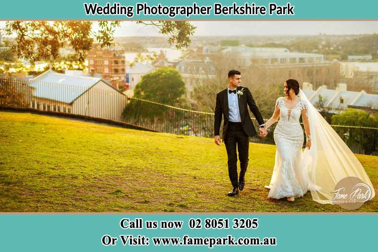 Photo of the Groom and the Bride walking at the yard Berkshire Park NSW 2765