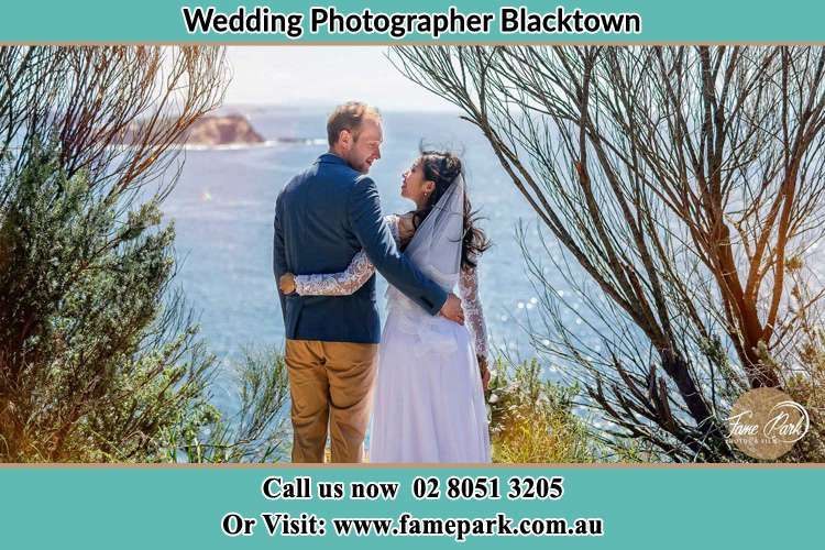 Photo of the Groom and the Bride looking each other near the sea front Blacktown NSW 2148