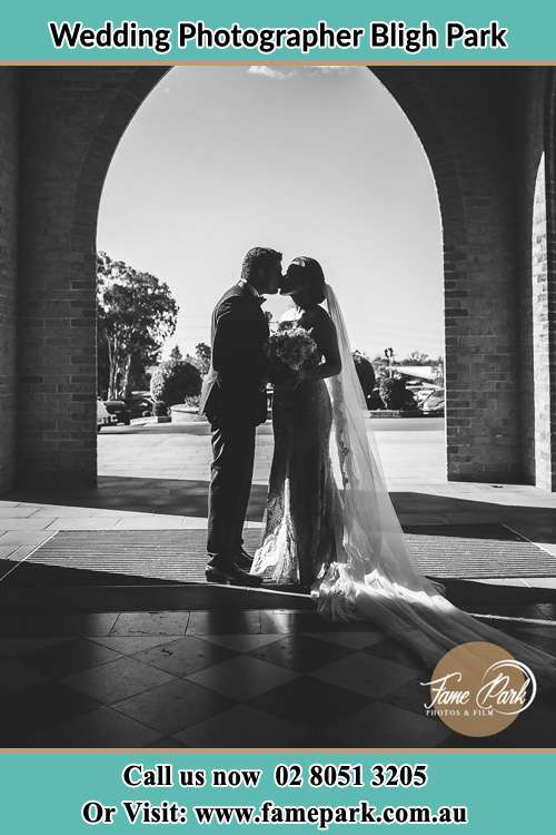 Photo of the Bride and the Groom kissing at the front of the church Bligh Park NSW 2756