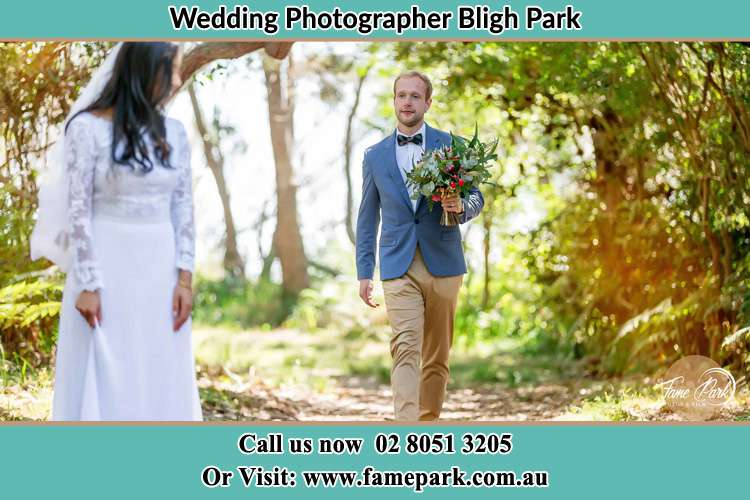 Photo of the Groom bringing flower to the Bride Bligh Park NSW 2756