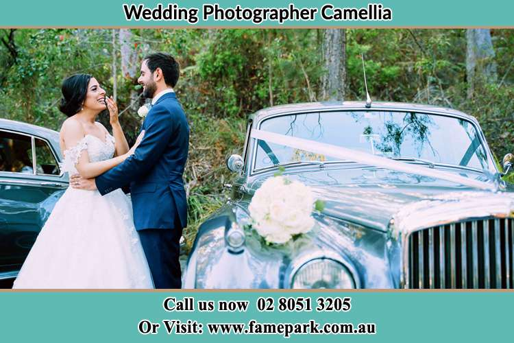 Photo of the Bride and the Groom near the bridal car Camellia NSW 2142