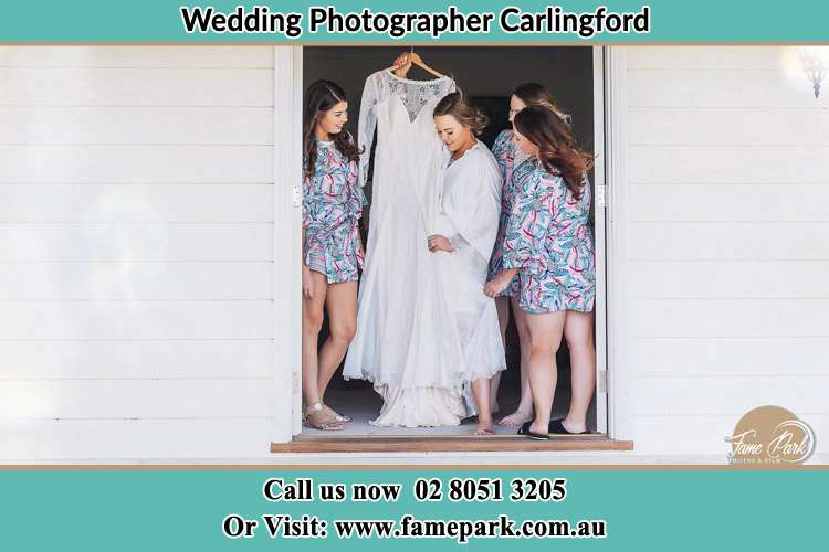 Photo of the Bride and the bridesmaids checking tj wedding gown at the door Carlingford NSW 2118