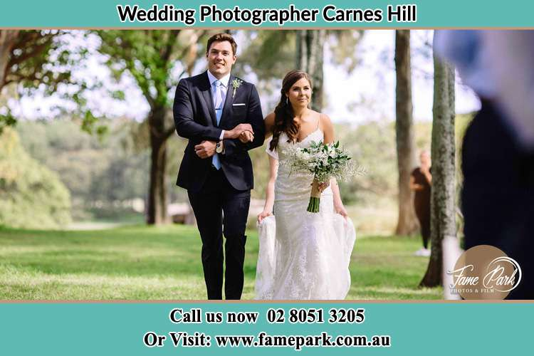 Photo of the Groom and the Bride walking Carnes Hill NSW 2171