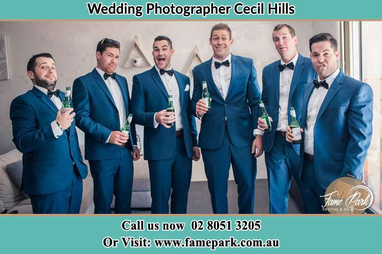 The groom and his groomsmen striking a wacky pose in front of the camera Cecil Hills NSW 2171