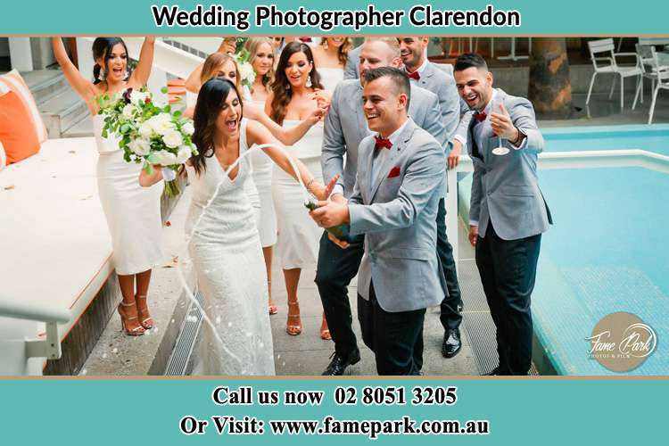 Photo of the Bride and the Groom celebrating with the secondary sponsors Clarendon NSW 2756