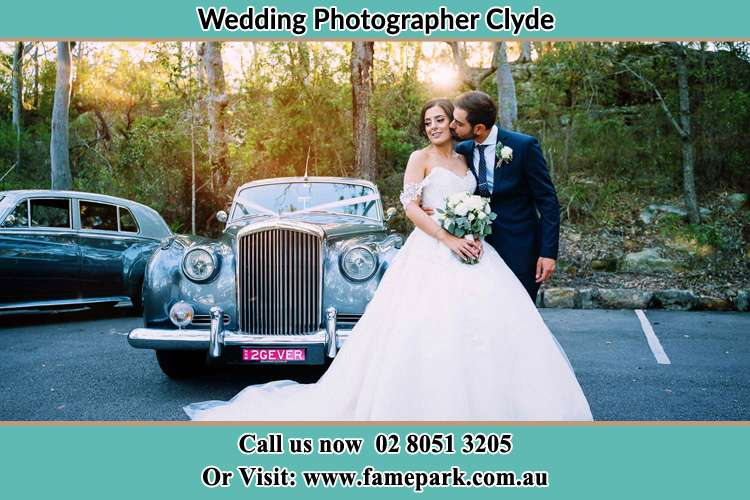 Photo of the Bride and the Groom at the front of the bridal car Clyde NSW 2142