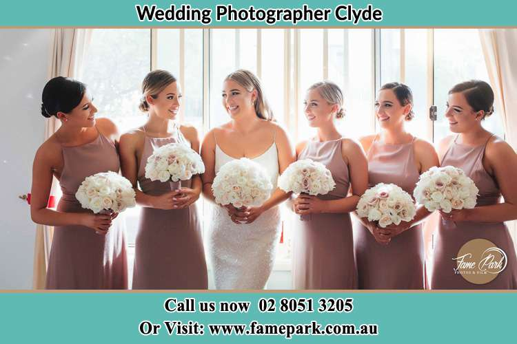 Photo of the Bride and the bridesmaids holding flower bouquet Clyde NSW 2142