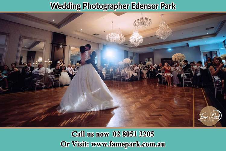 Photo of the Bride and the Groom hugging on the dance floor Edensor Park NSW 2176