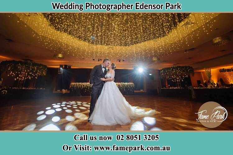Photo of the Groom and the Bride kissing on the dance floor Edensor Park NSW 2176