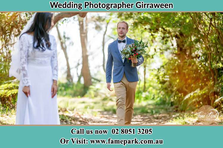Photo of the Groom bringing flower to the Bride Girraween NSW 2145