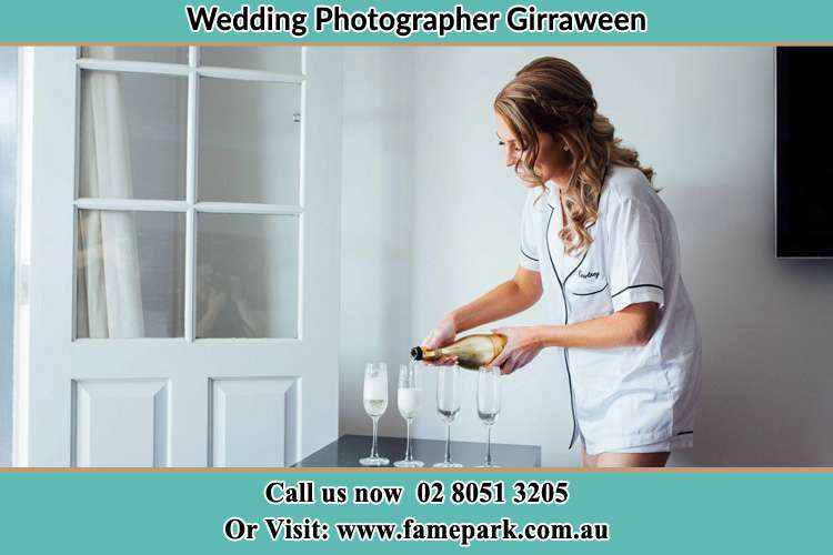 Photo of the Bride pouring wine to the glasses Girraween NSW 2145