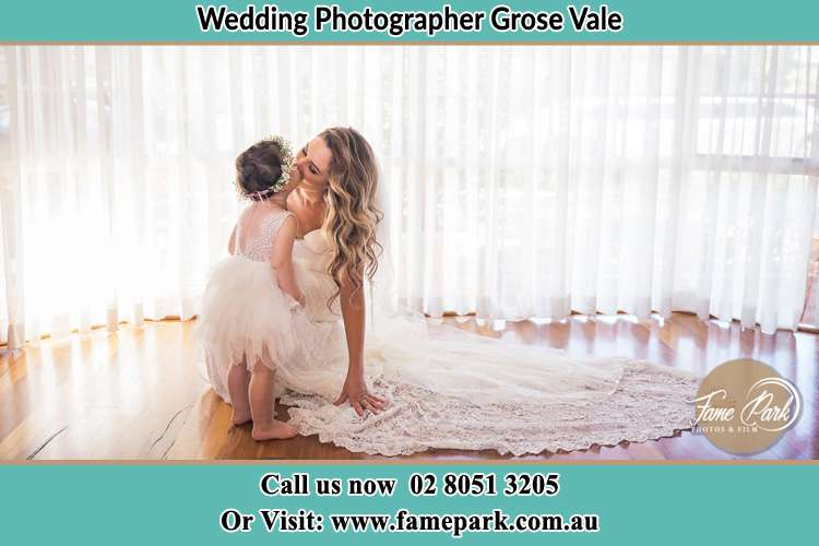 Photo of the Bride kiss the flower girl Grose Vale NSW 2753