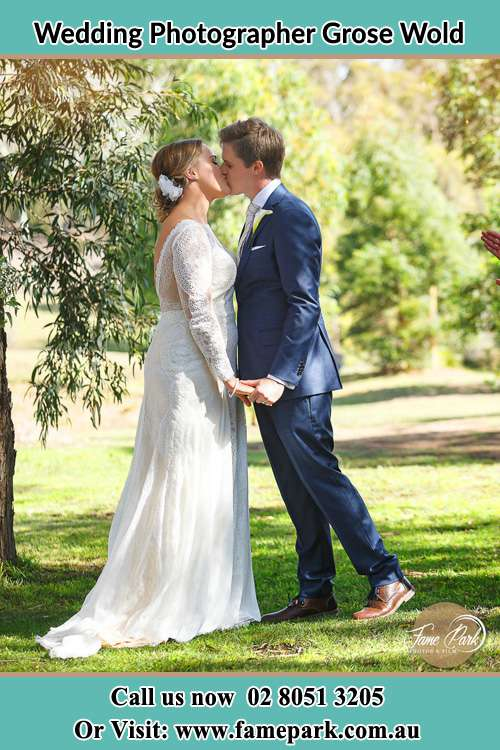 Photo of the Bride and the Groom kissing at the yard Grose Wold NSW 2753