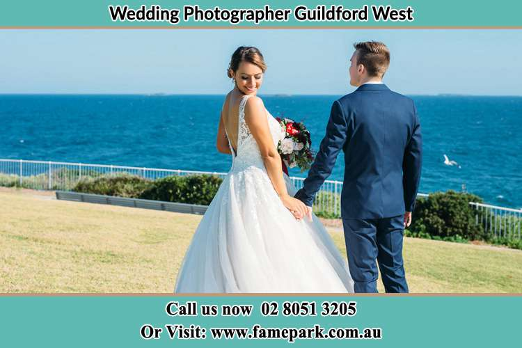 Photo of the Bride and the Groom holding hands at the yard Guildford West NSW 2161