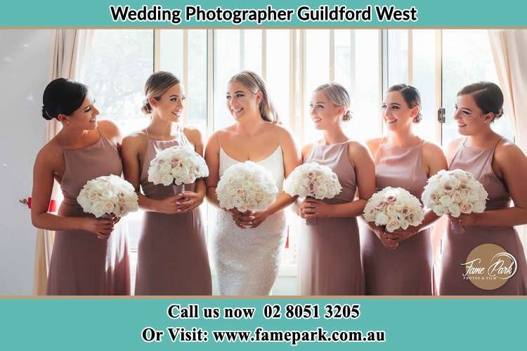 Photo of the Bride and the bridesmaids holding flower bouquet Guildford West NSW 2161