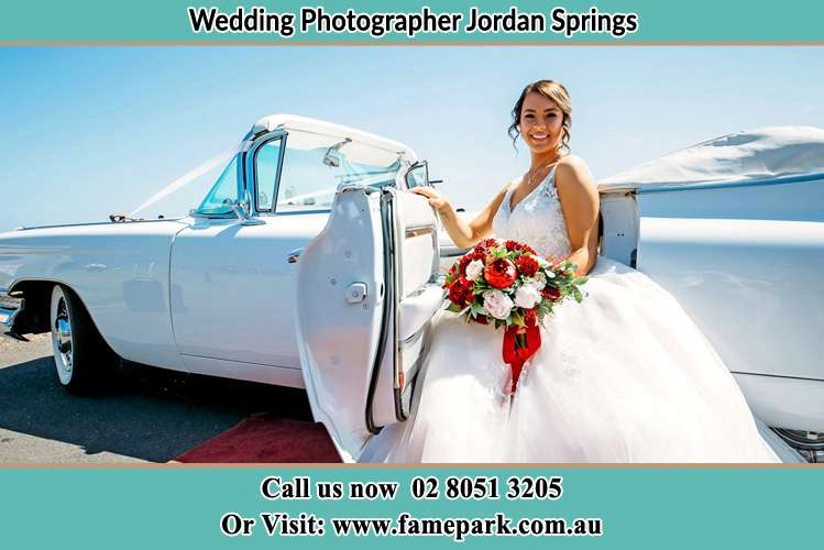Photo of the Bride outside the bridal car Jordan Springs NSW 2747