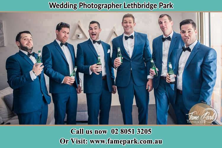 The groom and his groomsmen striking a wacky pose in front of the camera Lethbridge Park NSW 2770