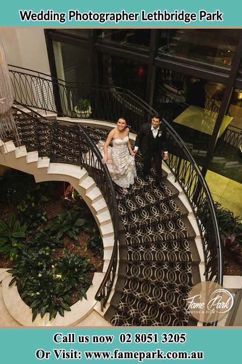 Photo of the Bride and the Groom walking down the stair Lethbridge Park NSW 2770