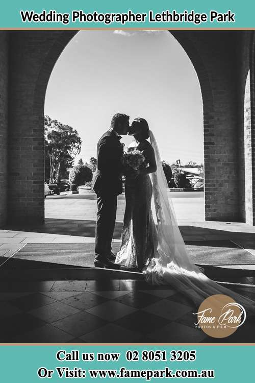 Photo of the Groom and the Bride kissing near the church Lethbridge Park NSW 2770