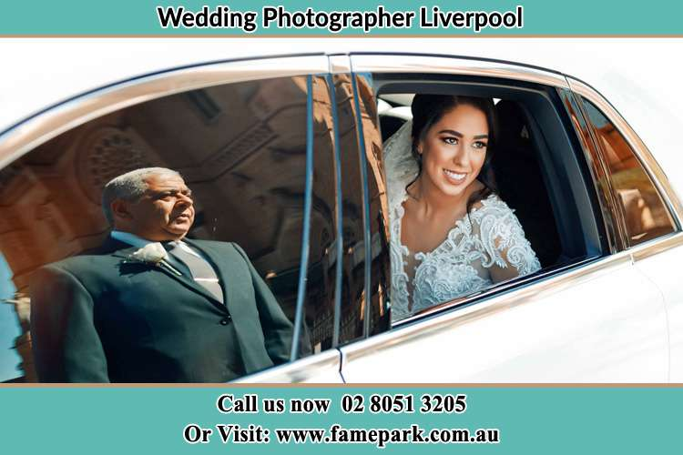 Photo of the Bride inside the bridal car with her father standing outside Liverpool NSW 2170