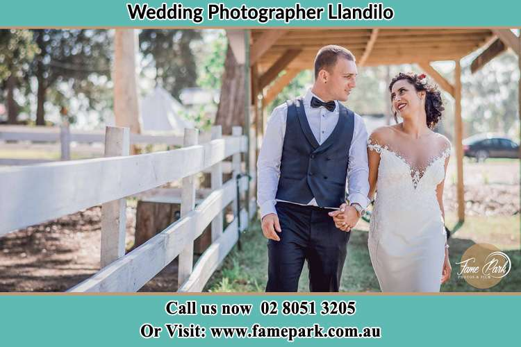 Photo of the Groom and the Bride holding hands while walking Llandilo NSW 2747