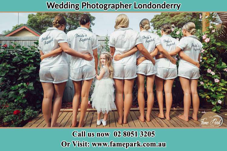 Behind photo of the Bride and the bridesmaids with the flower girl looking back Londonderry NSW 2753