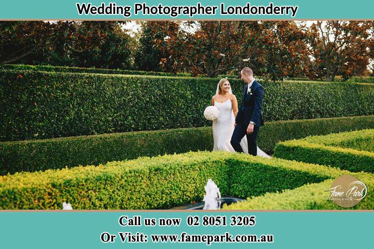 Photo of the Bride and the Groom walking at the garden Londonderry NSW 2753