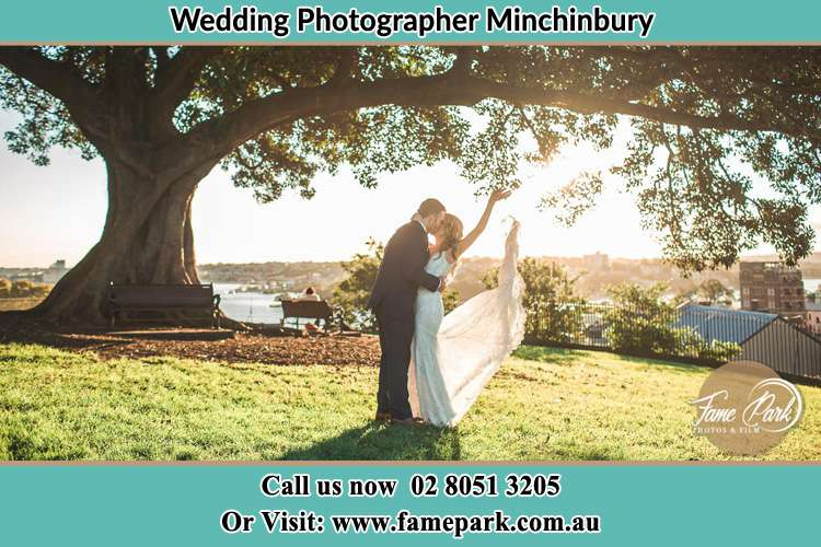 Photo of the Bride and the Groom kissing under the tree Minchinbury NSW 2770