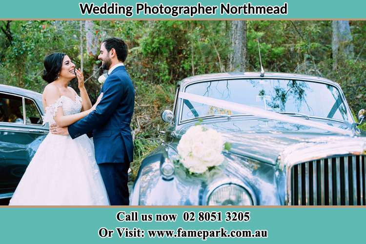 Photo of the Bride and the Groom near the bridal car Northmead NSW 2152