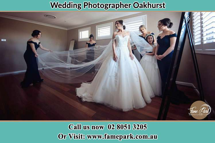 Photo of the Bride and the secondary sponsor preparing Oakhurst NSW 2761