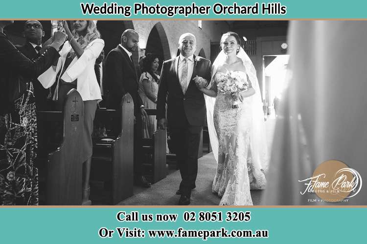 Photo of the Bride with her father walking the aisle Orchard Hills NSW 2748