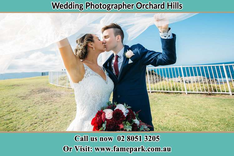 Photo of the Bride and the Groom kissing at the yard Orchard Hills NSW 2748