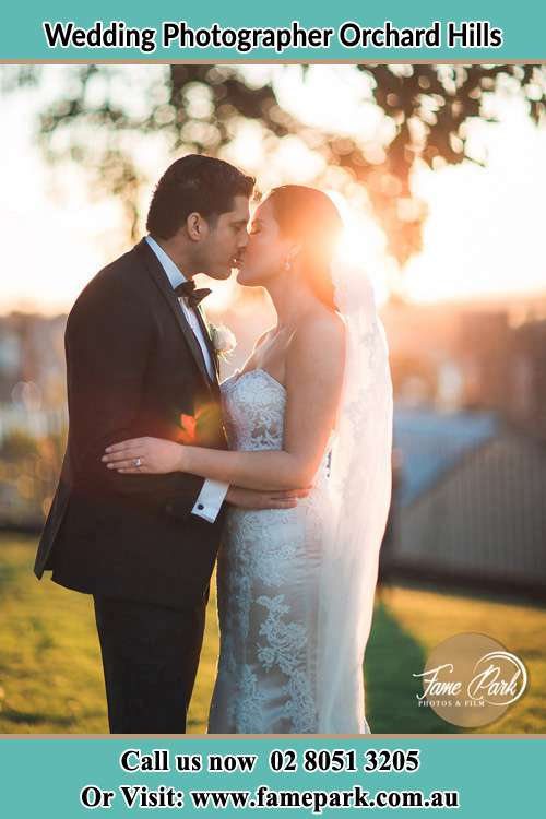 Photo of the Groom and the Bride kissing at the yard Orchard Hills NSW 2748