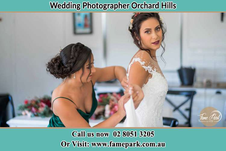 Photo of the Bride and the bridesmaid getting ready Orchard Hills NSW 2748