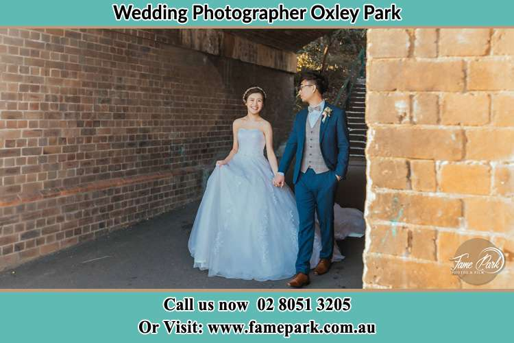 Photo of the Bride and the Groom walking Oxley Park NSW 2760