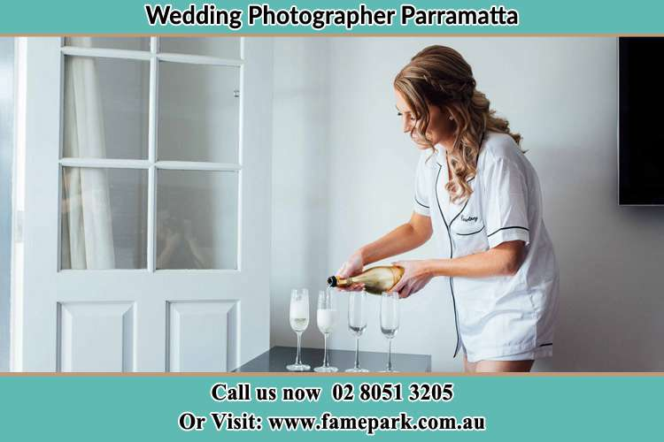 Photo of the Bride pouring wine on the glasses Parramatta NSW 2150