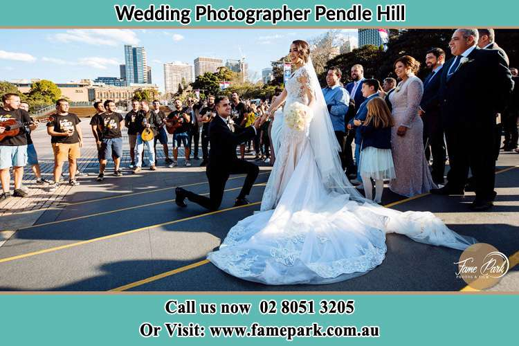 Groom Kneeling down in front of the Bride Pendle Hill NSW 2145