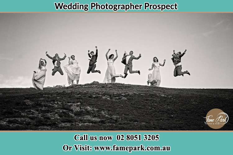 Jump shot photo of the Groom and the Bride with the entourage Prospect NSW 2148
