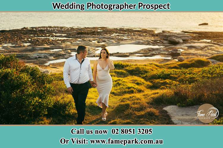 Photo of the Groom and the Bride walking near the lake Prospect NSW 2148