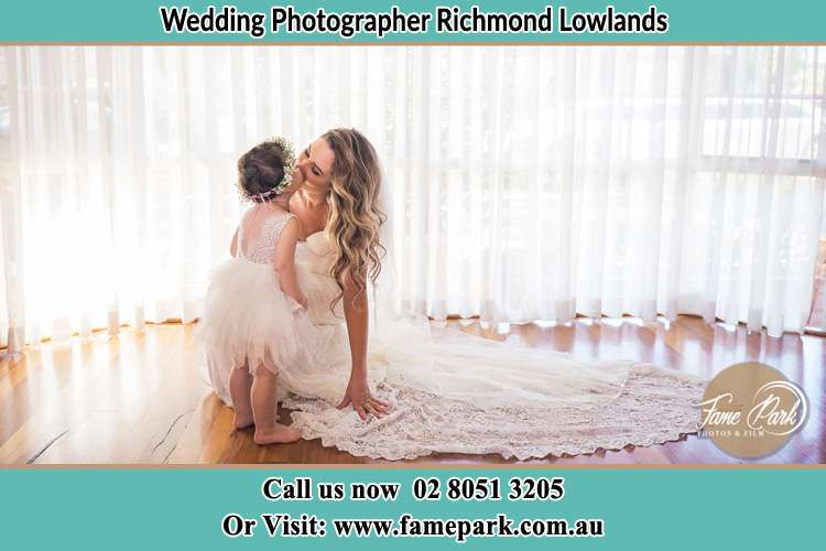 Photo of the Bride kiss the flower girl Richmond Lowlands NSW 2753