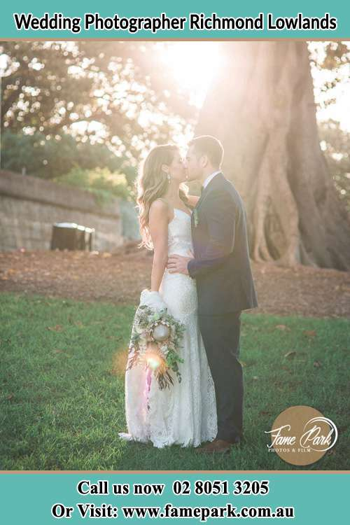 Photo of the Bride and the Groom kissing at the yard Richmond Lowlands NSW 2753