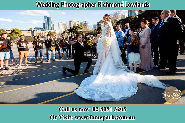 Groom Kneeling down in front of the Bride Richmond Lowlands NSW 2753