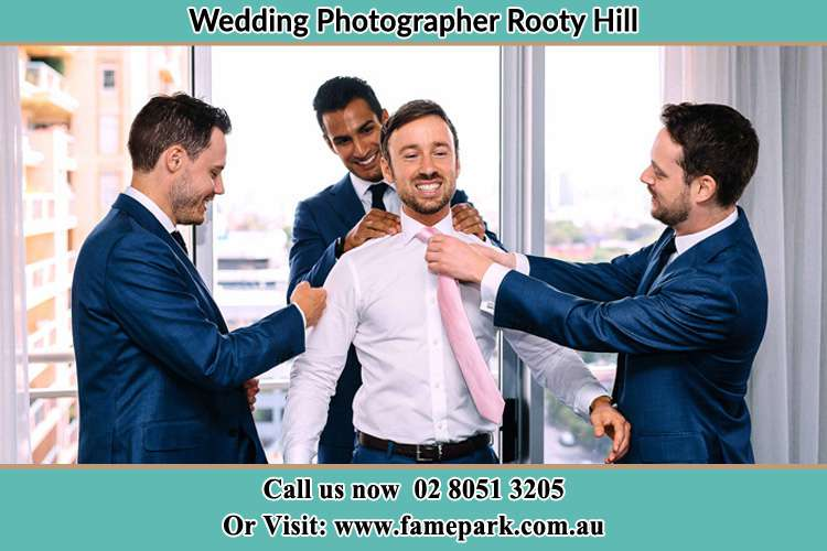 Photo of the Groom helping by the groomsmen getting ready Rooty Hill NSW 2766