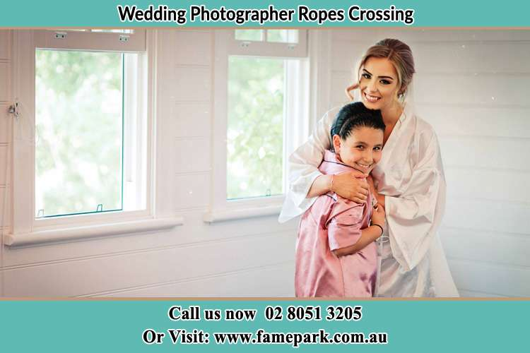 Photo of the Bride hugging the flower girl Ropes Crossing NSW 2760