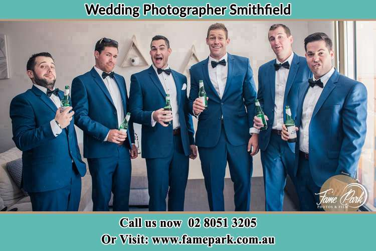 The groom and his groomsmen striking a wacky pose in front of the camera Smithfield NSW 2164