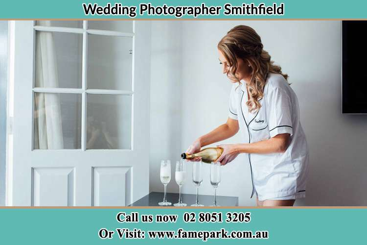 Photo of the Bride pouring wine on the glasses Smithfield NSW 2164