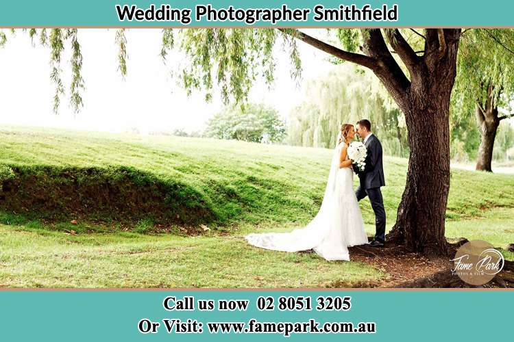 Photo of the Bride and the Groom kissing under the tree Smithfield NSW 2164