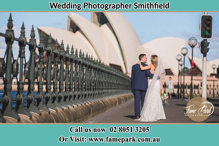 The Groom and the Bride walking towards the Sydney Grand Opera House Smithfield NSW 2164