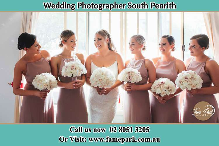 Photo of the Bride and the bridesmaids holding flower bouquet South Penrith NSW 2750